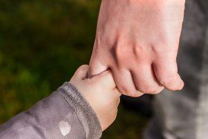 nanny holding child's hand