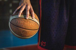 Mysetery NBA star holding basketball